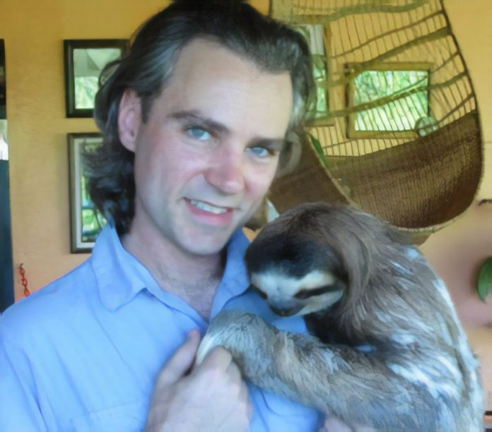 The author with Buttercup, a three-toed sloth