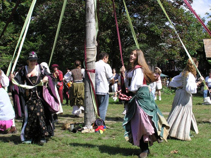 People dancing around a maypole