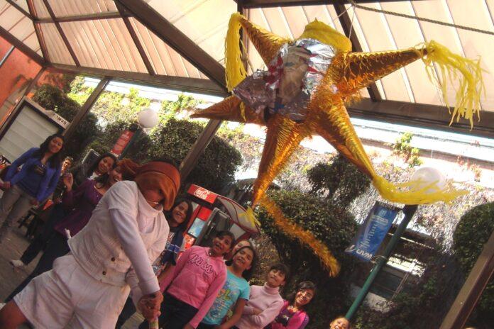 Children assaulting a piñata