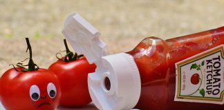 Tomatoes and a bottle of ketchup
