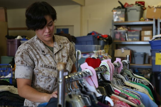 A Marine volunteering at a thrift shop
