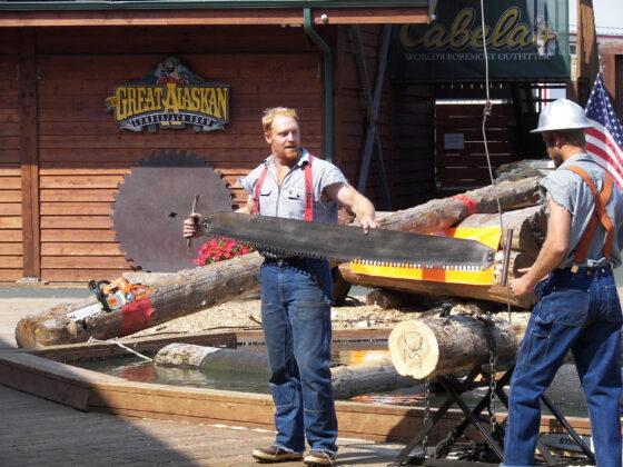 Lumberjacks in the crosscut saw event at the Great Alaskan Lumberjack Show in Ketchikan, Alaska