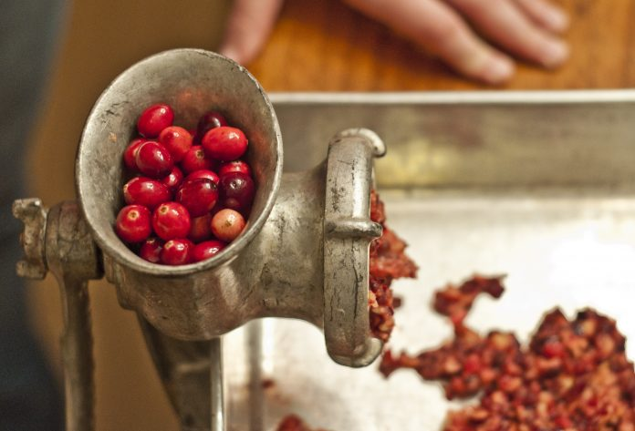 Cranberries being ground for relish