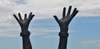 Detail of statue depicting arms of freed slave, Le Pêcheur, Martinique