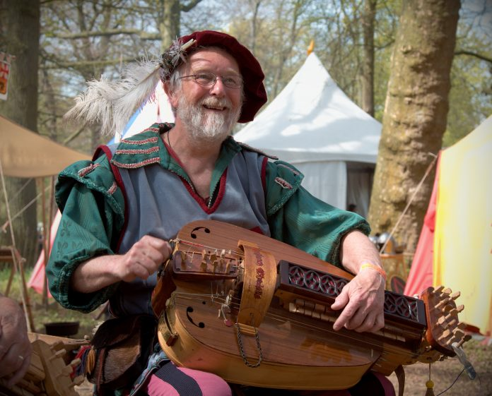A musician playing the hurdy-gurdy