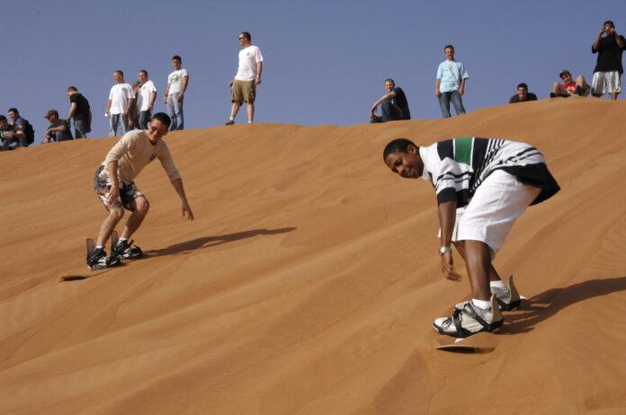 People sandboarding