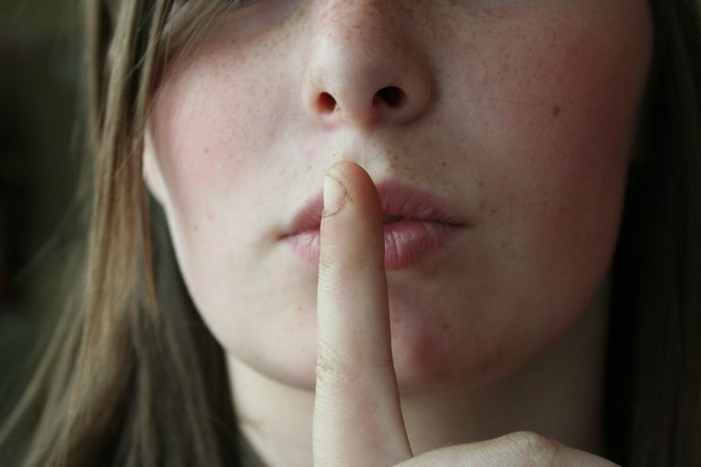 """Woman making the """"shhhh"""" gesture"""