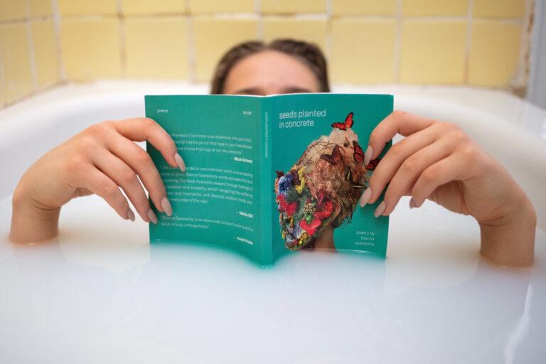 Woman reading in a bathtub