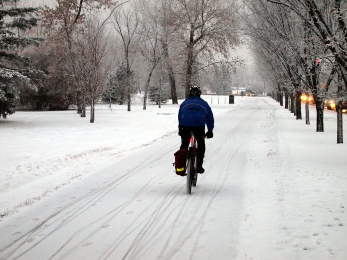 Winter Cyclists on Bow River Pathway