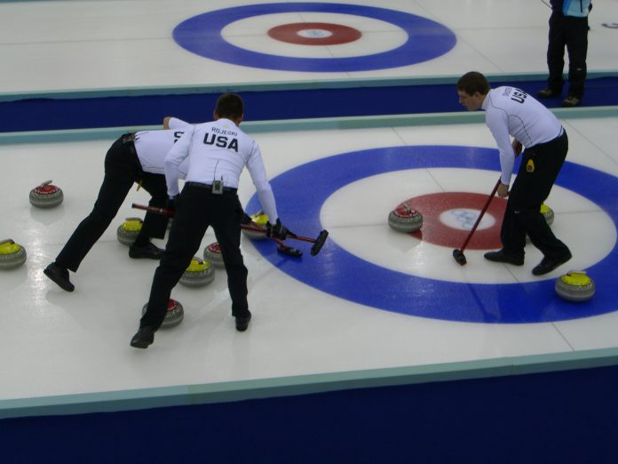 The U.S. men's curling team competing at the 2006 Olympics