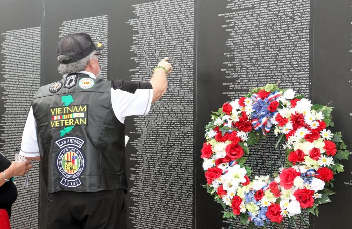 A Vietnam War veteran recognizes a name on the American Veteran Traveling Wall