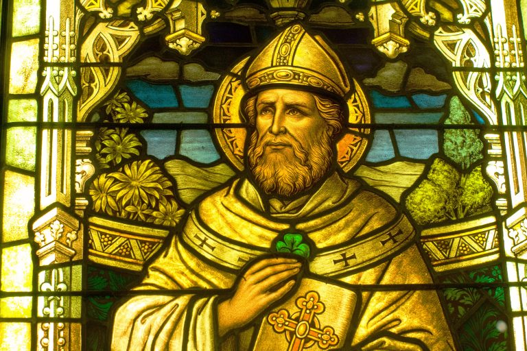 Detail of St Patrick with a shamrock in a stained glass window at the Smith Museum of Stained Glass Windows at Navy Pier in Chicago