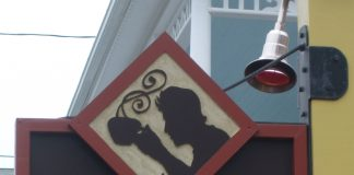 Joe coffee and espresso sign, 170 Commercial Street, Provincetown, Massachusetts, USA
