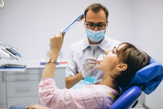 Woman patient at dentist