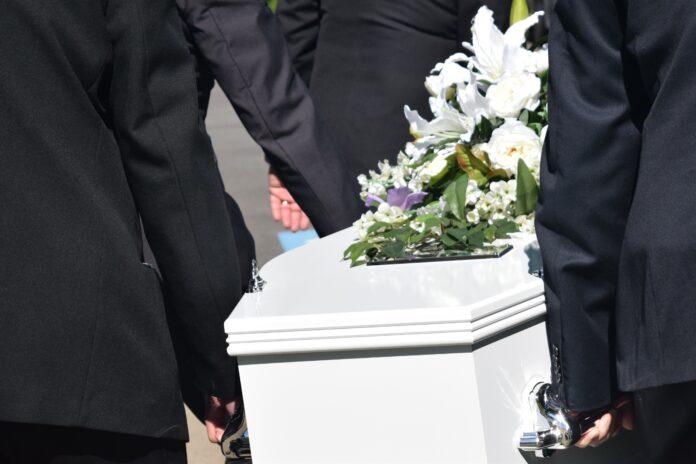 A coffin borne by pallbearers