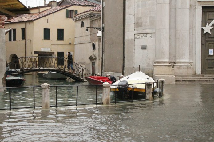 Hard to tell where the canal ends and the pavement begins, Venice floods 2012.