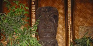 A Tiki statue in a Tiki bar